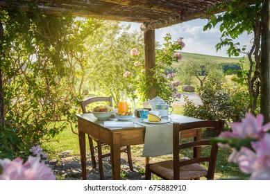 Breakfast under the gazebo in a sunny spring morning