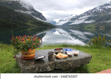 Breakfast with a view in Norway - cloudy Nordfjord view in Olden.