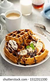 Breakfast waffles with bananas and chocolate sauce