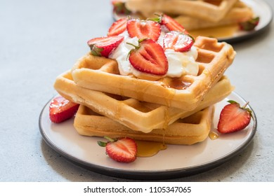 Breakfast with wholegrain belgian waffles with strawberry and honey