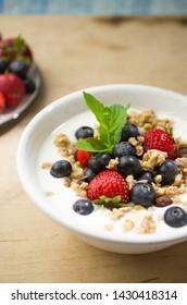 Breakfast yogurt with granola and fruits