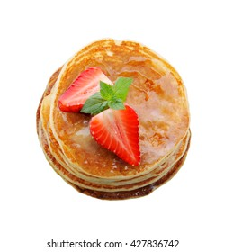 Breakfast.Pancakes with strawberry and honey.