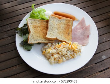 breakfast's fried rice, ham, bread and sausage