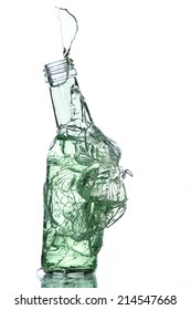 breaking bottle with liquid isolate on white background