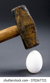Breaking the egg with old sledge hammer.