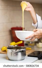 breaking eggs for making custard on home kitchen