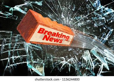 Breaking news with brick going through glass window.
