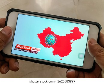Breaking news on mobile phone highlighting coronavirus outbreak in China. Coronavirus also known as Covid 19 is a deadly flu virus detected in Wuhan, China.