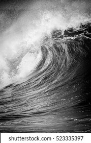 Breaking Ocean wave in black and white on the north shore of Oahu at Waimea bay Hawaii