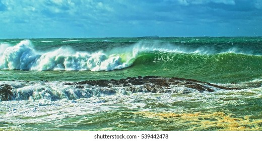 Breaking surf as a result of Seven meter(22 ft) seas just out side the entrance to Coffs Harbour.  Photographed in New South Wales, Australia.