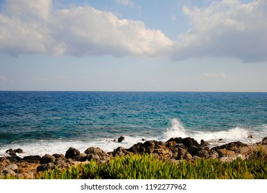 breaking wave at the coast of Sisi in Crete in Greece with plants nearby