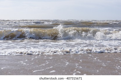 a breaking wave hits the coast of the netherlands