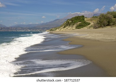 Breaking waves at the Komos Beach in the south west of the island Crete. In the background the IDA Mountains with the Pisiloritis as the highest elevation.