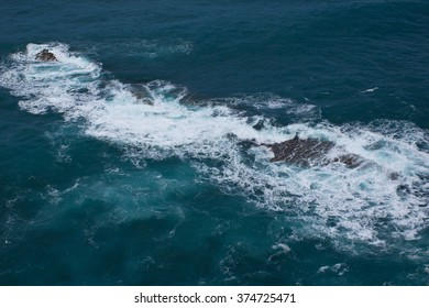 Breaking waves at rocky coast of Madeira Island, Portugal