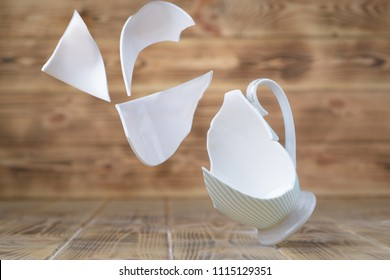 A breakout vintage porcelain cup on a wooden table