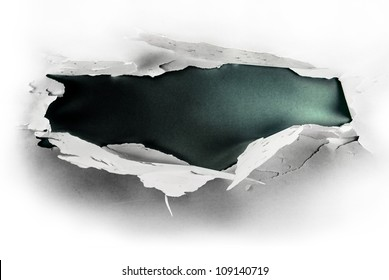 Breakthrough paper hole with dark background.