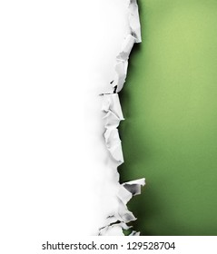 Breakthrough paper hole with green background inside, isolated on white.