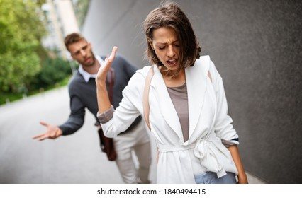 Breakup of couple with man and sad girlfriend outdoor. Divorce, couple, love, pain concept.