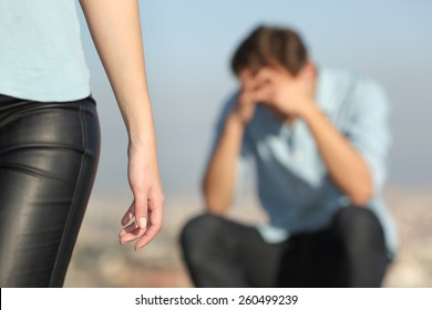 Breakup of a couple with a sad man in the background and the girlfriend leaving him in the foreground