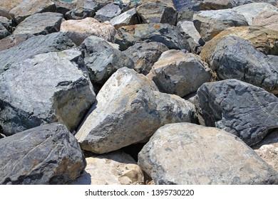 Breakwall Rocks at Aegean Sea Coast in Greece
