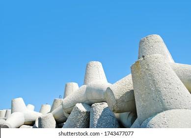Breakwater,  concrete stone breakwater blocks in sunlight day on seashore