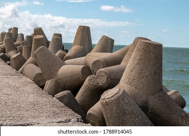 Breakwater concrete tetrapods, wave protection.