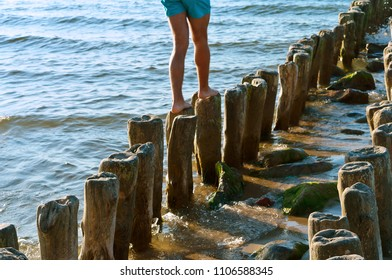 a breakwater made of wood, standing on the breakwater, the groynes in the sea, sea waves protection from