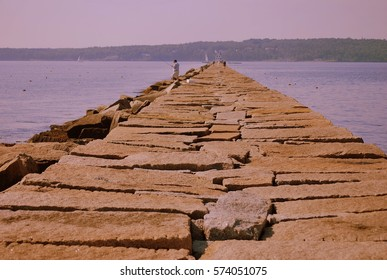 The Breakwater Path to the lighthouse. Jigsaw puzzled boulders leading to the Rockland Lighthouse stretching close to a mile long.