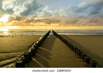 Breakwaters on the beach at sunset in Domburg, Zeeland,  Holland