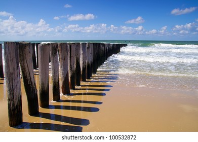 breakwaters on a sunny european beach, north sea in Domburg Holland
