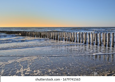 Breakwaters on a winter beach in Vlissingen Holland - Shutterstock ID 1679741563