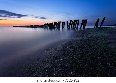 Breakwaters at twilight. Baltic Sea, Russia