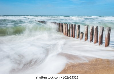 breakwaters with waves at the rough North sea
