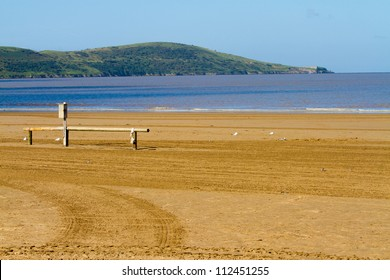 Brean Down peninsula photographed from the beach at Weston-super-Mare.  There is a fort on the end of Brean Down dating from the 1860`s