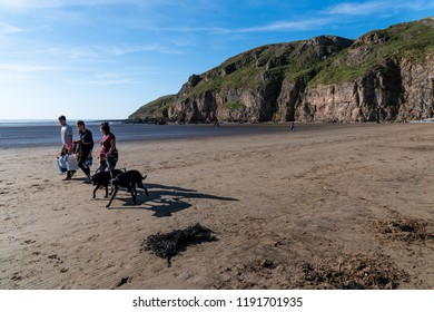 Brean, England, UK:  September 29, 2018: People walking on the Brean Sands Beach in the late autumn afternoon