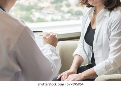 Breast cancer awareness healthcare concept with female patient having consultation with gynecologist doctor who consulting and diagnostic examining woman's health in medical clinic or hospital