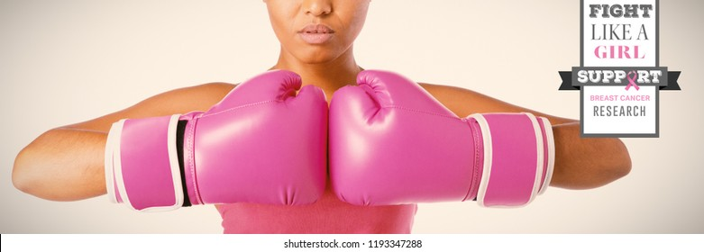 Breast cancer awareness message against woman for breast cancer awareness in boxing gloves