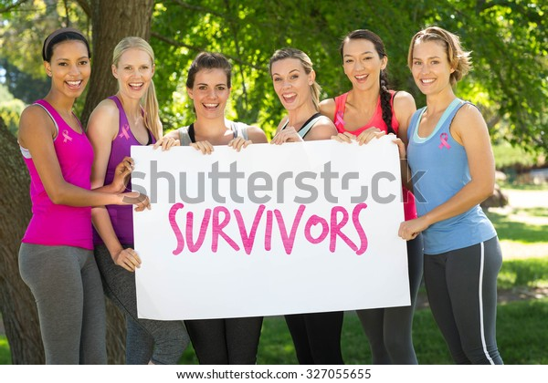 Breast cancer awareness message against fitness group holding poster in park