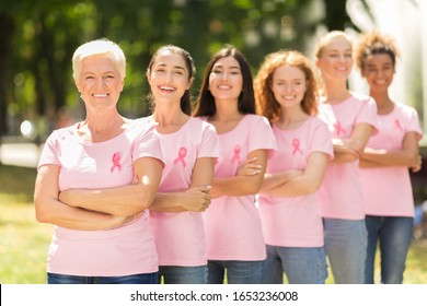 Breast Cancer. Mixed Women In T-Shirts With Pink Ribbons Symbol Standing In Line Outdoor. Shallow Depth