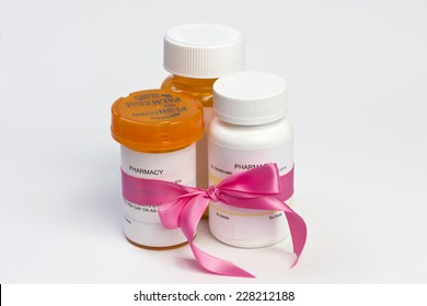 Breast cancer prescription medications with pink ribbon.