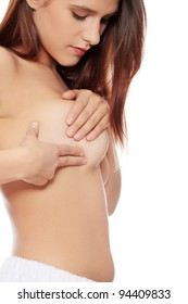 Breast cancer - Woman examining her breast