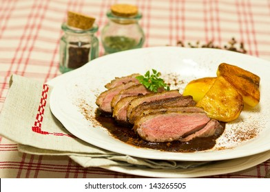 Breast of Duck (Magret de Canard) with cacao sauce and backed potatoes