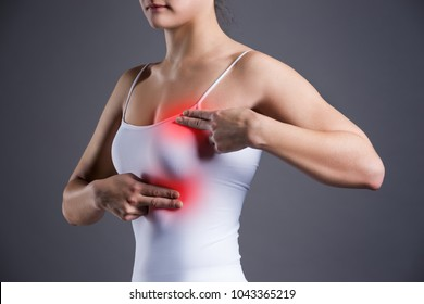 Breast test, woman examining her breasts for cancer, heart attack, pain in human body on gray background