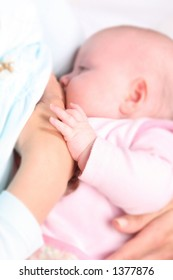 Breastfeeding - focus on tiny hand