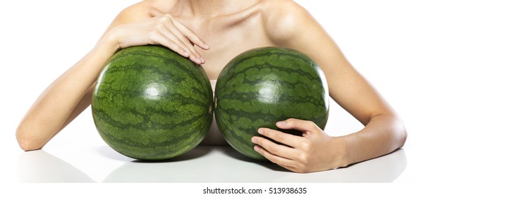 Breasts implant concept,Woman holding two watermelon in front of her breasts