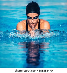 Breaststroke swimming woman
