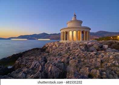 Breathless view of the Lighthouse of Saint Theodore and the Argostoli city in distance in Kefalonia island, Greece