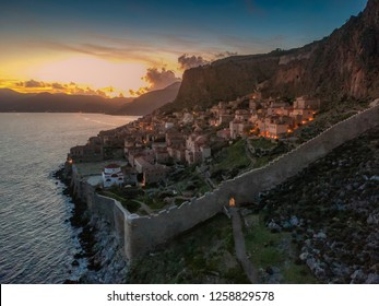 Breathtaking aerial panorama of the fortified medieval castle town of Monemavasia at sunset. Majestic scenery over the picturesque ancient town Monemvasia in Laconia, Peloponnese, Greece, Europe