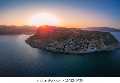 Breathtaking aerial panoramic view of the fortified medieval castle town of Monemavasia at sunset. Majestic scenery over the picturesque coastal town Monemvasia in Lakonia, Peloponnese, Greece, Europe
