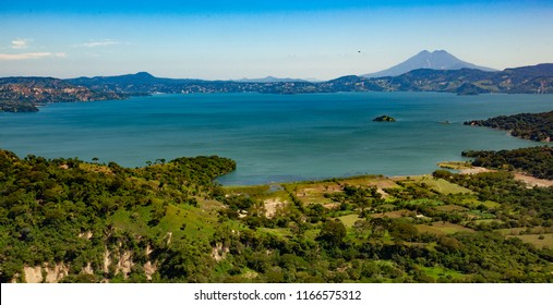 Breathtaking aerial shot of Ilopango Lake, San Salvador, El Salvador, Central América. This body of water hides one of the most dangerous caldera volcanoes of the World. Chinchontepec, San Vicente.